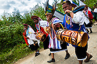 """Natives from the Kamentsá tribe play drums and wind instruments during the Carnival of Forgiveness, a traditional indigenous celebration in Sibundoy, Colombia, 12 February 2013. Clestrinye (""""Carnaval del Perdón"""") is a ritual ceremony kept for centuries in the Valley of Sibundoy in Putumayo (the Amazonian department of Colombia), a home to two closely allied indigenous groups, the Inga and Kamentsá. Although the festival has indigenous origins, the Catholic religion elements have been introduced and merged with the shamanistic tradition. Celebrating annually the collaboration, peace and unity between tribes, they believe that anyone who offended anyone may ask for forgiveness this day and all of them should grant pardons."""