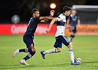LAKE BUENA VISTA, FL - JULY 26: Cristián Gutiérrez of Vancouver Whitecaps FC is pressured by Khiry Shelton of Sporting KC during a game between Vancouver Whitecaps and Sporting Kansas City at ESPN Wide World of Sports on July 26, 2020 in Lake Buena Vista, Florida.