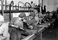 Women workers in ordnance shops, Midvale Steel and Ordnance Co., Nicetown, Pa.  Hand chipping with pneumatic hammers.  1918.  Lt. Lubbe.  (Army)<br />Exact Date Shot Unknown<br />NARA FILE #:  111-SC-31731<br />WAR & CONFLICT BOOK #:  545