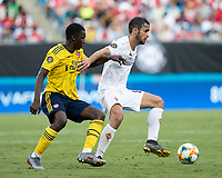 CHARLOTTE, NC - JULY 20: Luca Ranieri #6 holds off Eddie Nketiah #30 during a game between ACF Fiorentina and Arsenal at Bank of America Stadium on July 20, 2019 in Charlotte, North Carolina.