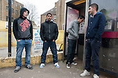 Unemployed young men from Poland and Slovakia pass time on a street corner in Cliftonville, Margate.