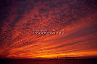 Sunset paints low clouds over Narragansett bay and Newport bridge