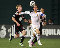 Dax McCarty (10) of D.C. United moves in on David Beckham (23) of the Los Angeles Galaxy during an MLS match at RFK Stadium, on April 9 2011, in Washington D.C.The game ended in a 1-1 tie.