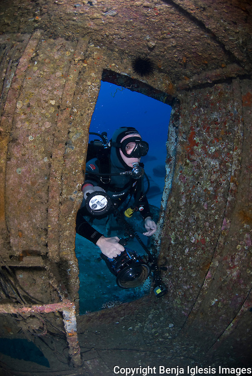 Photogrpaher getting inside st Anthonys wreck Maui Hawaii.