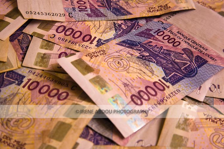 10,000 cfa bills (West African currency, used in Senegal, Mali, Burkina Faso, Niger, Togo, Benin, and the Ivory Coast.