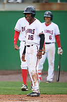 Potomac Nationals Victor Robles (16) waits to congratulate Taylor Gushue (not shown) after a home run during the first game of a doubleheader against the Salem Red Sox on May 13, 2017 at G. Richard Pfitzner Stadium in Woodbridge, Virginia.  Potomac defeated Salem 6-0.  (Mike Janes/Four Seam Images)