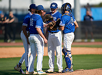 Canterbury Cougars mounds meeting with Jake O'Connell (28), Evan Ames (10), Connor O'Connell (22), and Eric DeMarco (4) during a game against the IMG Academy Ascenders on April 21, 2021 at IMG Academy in Bradenton, Florida.  (Mike Janes/Four Seam Images)