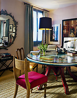 The dining room of Lars Rachen's Venetian apartment features a circular Fornasetti painted table