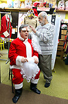 WATERBURY CT. 22 December 2017-122217SV05-Mike Patrick, Republican American, sees what it feels like to transform into Santa at Arabesque on Bank Street in Waterbury Friday. Michael Rinaldi, owner dressed Mike.<br /> Steven Valenti Republican-American