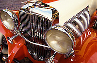 Close up of turbo charged Veteran car front with big crome head lights