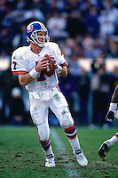 OAKLAND, CA - Quarterback John Elway of the Denver Broncos in action during a game against the Oakland Raiders at the Oakland Coliseum in Oakland, California in 1995. Photo by Brad Mangin