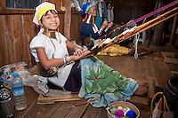 Myanmar, Burma.  Padaung Women with Brass Neck Coils, Inle Lake, Shan State.  The young woman has traces of thanaka paste on her face, a cosmetic sunscreen.  The Padaung are also called Kayan Lahwi.