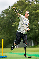 BNPS.co.uk (01202 558833)<br /> Pic: MaxWillcock/BNPS<br /> <br /> Pictured: Rob Franks practising leg spin bowling at Parley Cricket Club in West Parley, Dorset.<br /> <br /> Disabled cricketer Rob Franks is back in the runs after raising £12,000 to buy a prosthetic blade.<br /> <br /> Rob, 42, can now sprint between the wickets when batting, run into bowl and chase after the ball in the field. <br /> <br /> Rob Franks, from Poole, Dorset, had his left leg amputated above the knee three years ago after suffering an injury while playing a match.