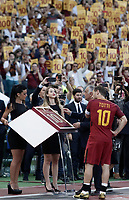 Calcio, Serie A: Roma, stadio Olimpico, 28 maggio 2017.<br /> AS Roma's president James Pallotta gives a framed Number 10 to Francesco Totti during a ceremony to celebrate his last match with AS Roma after during the Italian Serie A football match between AS Roma and Genoa at Rome's Olympic stadium, May 28, 2017.<br /> Francesco Totti's final match with Roma after a 25-season career with his hometown club.<br /> UPDATE IMAGES PRESS/Isabella Bonotto