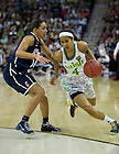 Apr 7, 2013; Notre Dame Skylar Diggins drives past Connecticut Bria Hartley during the second half of the semifinals of the 2013 NCAA women's basketball Final Four at the New Orleans Arena. Connecticut defeated Notre Dame 83 to 65. Photo by Barbara Johnston/ University of Notre Dame