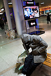 A homeless man catches a few moments of sleep at Seoul's central train station.<br /> <br /> The Red Cross in Seoul provide feeding and other services for the capital's homeless.