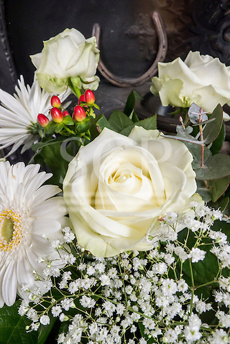 Bedfordshire, England. White rose bouquet for a wedding.