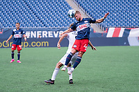 FOXBOROUGH, MA - JULY 4: Pierre Cacet #44 of the New England Revolution II heads the ball off a goalie kick during a game between Greenville Triumph SC and New England Revolution II at Gillette Stadium on July 4, 2021 in Foxborough, Massachusetts.