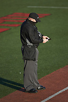Home plate umpire Todd Mullins updates his lineup card after a pitching change during the NCAA baseball game between the Valparaiso Crusaders and the Western Kentucky Hilltoppers at Nick Denes Field on March 19, 2021 in Bowling Green, Kentucky. (Brian Westerholt/Four Seam Images)