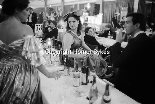 Westminster, London. 1982<br /> The belle of the ball in an off one-shoulder gown and an overly large bow headpiece at the annual Rose Ball, at the Grosvenor House Hotel.