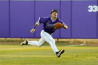 Right fielder Landon Kay (44) of the Furman Paladins goes full out to chase down a fly ball in game two of a doubleheader against the Harvard Crimson on Friday, March 16, 2018, at Latham Baseball Stadium on the Furman University campus in Greenville, South Carolina. Furman won, 7-6. (Tom Priddy/Four Seam Images)