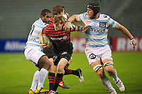 20121020 Copyright onEdition 2012©.Free for editorial use image, please credit: onEdition..David Strettle of Saracens forces his way between Jacques Cronje (right) and Sakiusa Matadigo of Racing Metro 92 during the Heineken Cup Round 2 match between Saracens and Racing Metro 92 at the King Baudouin Stadium, Brussels on Saturday 20th October 2012 (Photo by Rob Munro)..For press contacts contact: Sam Feasey at brandRapport on M: +44 (0)7717 757114 E: SFeasey@brand-rapport.com..If you require a higher resolution image or you have any other onEdition photographic enquiries, please contact onEdition on 0845 900 2 900 or email info@onEdition.com.This image is copyright the onEdition 2012©..This image has been supplied by onEdition and must be credited onEdition. The author is asserting his full Moral rights in relation to the publication of this image. Rights for onward transmission of any image or file is not granted or implied. Changing or deleting Copyright information is illegal as specified in the Copyright, Design and Patents Act 1988. If you are in any way unsure of your right to publish this image please contact onEdition on 0845 900 2 900 or email info@onEdition.com