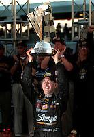 Nascar Nextel Cup driver Kurt Busch celebrates after winning the 2004 championship in Miami. Mandatory Credit: Mark J. Rebilas