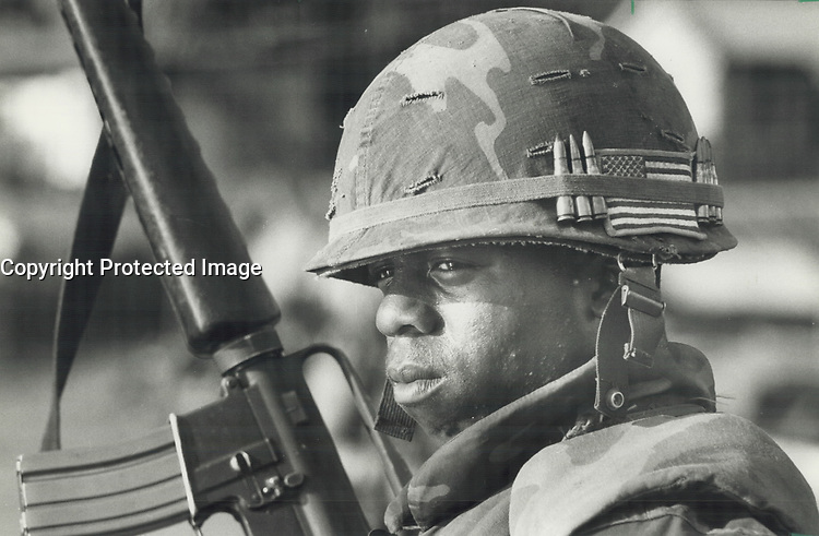Grenada Guard; A U.S. Marine stands guard at one of the main bridges on the road leading to St. George's during the American invasion of Grenada.<br /> <br /> Photo : Boris Spremo - Toronto Star archives - AQP