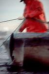 Native American fisherman, gill netting salmon, Duwamish river, Seattle, Puget Sound, Washington State, USA,.