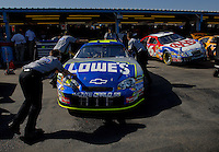 Apr 20, 2006; Phoenix, AZ, USA; The car of Nascar Nextel Cup racer Jimmy Johnson, driver of the (48) Lowes Home Improvement Chevrolet Monte Carlo is pushed into the garage prior to practice for the Nextel Cup Subway Fresh 500 at Phoenix International Raceway. Mandatory Credit: Mark J. Rebilas-US PRESSWIRE Copyright © 2006 Mark J. Rebilas..