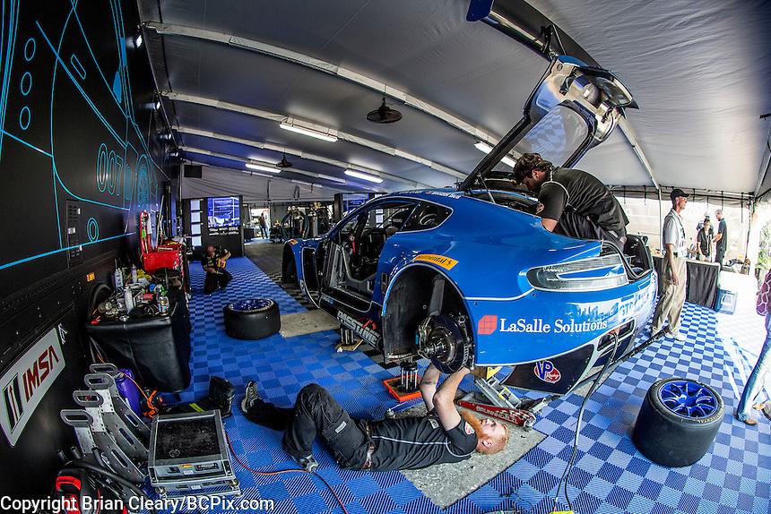 Paddock work, #007 Aston Martin, Brandon Davis, James Davison, Christina Nielsen 12 Hours of Sebring, Sebring International Raceway, Sebring, FL, March 2015.  (Photo by Brian Cleary/ www.bcpix.com )