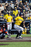 Michigan Wolverines outfielder Miles Lewis (3) follows through on his swing against the Illinois Fighting Illini during the NCAA baseball game on April 8, 2017 at Ray Fisher Stadium in Ann Arbor, Michigan. Michigan defeated Illinois 7-0. (Andrew Woolley/Four Seam Images)