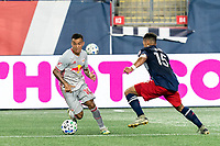 FOXBOROUGH, MA - AUGUST 29: Kaku #10 of New York Red Bulls dribbles as Brandon Bye #15 of New England Revolution defends during a game between New York Red Bulls and New England Revolution at Gillette Stadium on August 29, 2020 in Foxborough, Massachusetts.