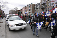 Montreal (QC) CANADA - April  4, 2012 - Quebec students on strike againt tuition fees increase,walk on Saint-Denis street