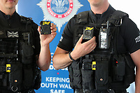 "AXON bodycams held by firearms police officers. Wednesday 17 May 2017<br /> Re: Body worn video cameras are being introduced into the South Wales Police force as part of operational equipment and will be rolled out over the next few months.<br />  Forces across the UK are using this technology and integrating it into daily policing activities.  Body worn video may be used in court as evidence and for investigative purposes, including complaints against police or as a training material for police. <br />  Other forces have seen a range of benefits from using body worn video to support their general patrolling and investigative tasks. These benefits include:<br /> Gathering and presentation of evidence<br /> Changing the behaviour of offenders<br /> Lower incidence or escalation of violence<br /> Increased guilty pleas by defendants<br /> Increased time on patrol and less time spent on paperwork<br /> Improved public co-operation and interactions with police<br /> Improved transparency and accountability<br /> Professionalising police interaction<br /> Assistant Chief Constable Richard Lewis said: ""Equipping our officers with body worn cameras is the start of a new way we capture, utilise and share digital evidence.  The technology is very exciting and will assist officers and staff in doing their jobs, it will ensure that we are more accountable to the public that we serve and in turn build trust with our communities."