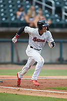 Laz Rivera (5) of the Birmingham Barons hustles down the first base line against the Pensacola Blue Wahoos at Regions Field on July 7, 2019 in Birmingham, Alabama. The Barons defeated the Blue Wahoos 6-5 in 10 innings. (Brian Westerholt/Four Seam Images)