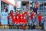 Triona Sheehy Teacher left and Barbara Dineen SET back and Sinead Fitzgerald SNA right with their Junior Infant class in Holy Cross Mercy Killarney on Monday (School has a no name policy)