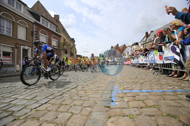 The peleton pass through the ancient town of Cassel during Stage 4 of the 2014 Tour de France running 163.5km from Le Touquet to Lille. 8th July 2014.<br /> Picture: Eoin Clarke www.newsfile.ie