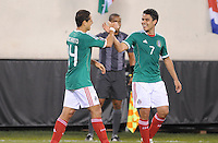 Mexico Javier Hernadez (14) celebrates with Pablo Barrera (7) his score.    Mexico defeated Guatemala 2-1 in the quaterfinals for the 2011 CONCACAF Gold Cup , at the New Meadowlands Stadium, Saturday June 18, 2011.