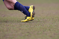 A Wounded Knee FC player wears yellow football boots during the Hackney Gazette Cup Final at Leyton Football Club - 20/04/08 - MANDATORY CREDIT: Gavin Ellis/TGSPHOTO - Self billing applies where appropriate - Tel: 0845 094 6026