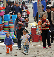 Mothers using Bei Bei to strap their children on the back to ensure their children's safety wherever the mothers go. Kunming is one of China's hot-spots for child abductions in China.
