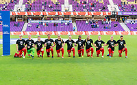 ORLANDO, FL - FEBRUARY 21: Canada kneels during their national anthem before a game between Canada and Argentina at Exploria Stadium on February 21, 2021 in Orlando, Florida.