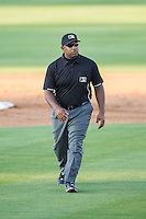South Atlantic League umpire Brad Polk handles the calls on the bases during the game between the Hickory Crawdads and the Kannapolis Intimidators at CMC-Northeast Stadium on May 4, 2014 in Kannapolis, North Carolina.  The Intimidators defeated the Crawdads 3-1.  (Brian Westerholt/Four Seam Images)