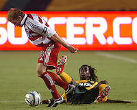 Los Angeles Galaxy's Joseph Ngwenya falls down as FC Dallas Bobby Rhine gets the ball in the second half at the Home Depot Center in Carson, CA on Saturday night, October 1, 2005..(Matt A. Brown/ISI)