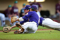 LSU Tigers first baseman Mason Katz #8 avoids colliding with pitcher Ryan Eades as they dive for a pop up against the Mississippi State Bulldogs during the NCAA baseball game on March 17, 2012 at Alex Box Stadium in Baton Rouge, Louisiana. The 10th-ranked LSU Tigers beat #21 Mississippi State, 4-3. (Andrew Woolley / Four Seam Images).