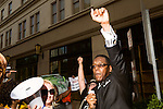 July 13, 2015. Winston Salem, North Carolina.<br />  Rev. Curtis Gatewood, right, raises his fist in support of the NC NAACP's voting rights case against Gov. Pat McCrory.<br />  To rally support for the North Carolina NAACP's case against Gov. Pat McCrory (NC NAACP v. McCrory), a march was held in downtown Winston Salem on the opening day of the case in federal court. Thousands gathered to walk the streets of downtown and listen to speeches proclaiming the importance of defeating new requirements for voter registration,<br />  The NC NAACP contests that HB 589 (Voter ID requirements) violate Section 2 of the Voting Rights Act (42 U.S.C. 1973) and the Fourteenth and Fifteenth Amendments of the Constitution.