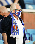A Kilmarnock fan with matching mask and scarf. Kilmarnock 2 Ayr United 0, Scottish Championship, August 2nd 2021. Following Kilmarnock's relegation in 2020-21, the first game of the new season is the Ayreshire Derby, the first league match between the teams in 28 years. Due to relaxation of Covid restrictions the match was played in front of a crowd of 3200 Kilmarnock fans. The game was shown live on BBC Scotland.