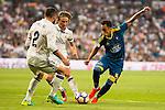 Real Madrid's player Daniel Carvajal and Luka Modric and Celta de Vigo's player Fabian Ariel Orellana during a match of La Liga Santander at Santiago Bernabeu Stadium in Madrid. August 27, Spain. 2016. (ALTERPHOTOS/BorjaB.Hojas)