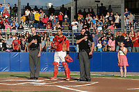 Batavia Muckdogs catcher Rodrigo Vigil (27) stands with umpires Brandin Sheeler (left) and Anthony Perez (right) as Emily Helenbrook sings the national anthem a game against the State College Spikes on July 3, 2014 at Dwyer Stadium in Batavia, New York.  State College defeated Batavia 7-1.  (Mike Janes/Four Seam Images)