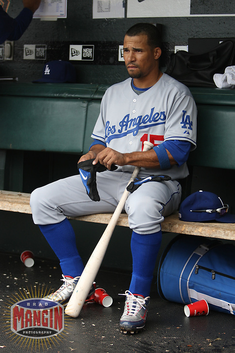 SAN FRANCISCO - SEPTEMBER 13:  Rafael Furcal of the Los Angeles Dodgers gets ready to bat in the dugout during the game against the San Francisco Giants at AT&T Park on September 13, 2009 in San Francisco, California. Photo by Brad Mangin